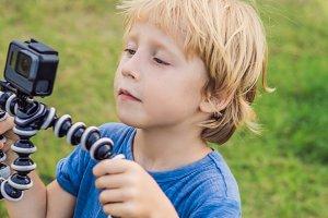 Little boy shoots a video on an