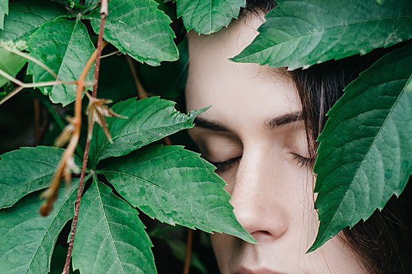People Images - Girl in green leaves enjoying nature