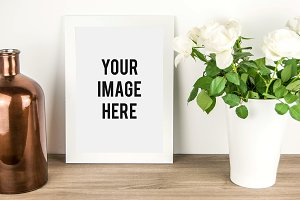 White Frame Mockup with Flowers