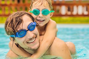 Dad and son in swimming Goggles have