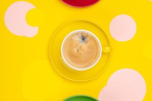 Cups of Coffee and colorful paper ci