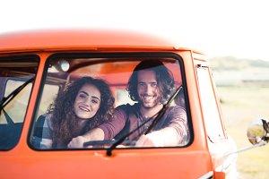 A young couple on a roadtrip through