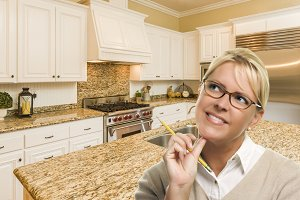 Woman with Pencil Inside Kitchen