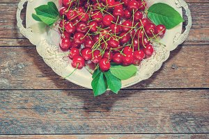 cherries in a metal plate