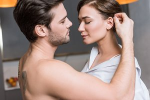 adult man gently touching girl hair