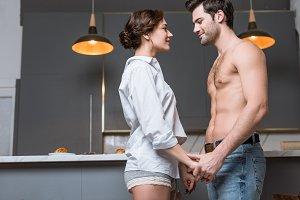 Adult tender couple looking into eye