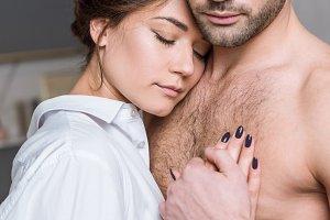 young tender girl gently hugging man