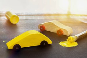 Toy cars with yellow paint brush and