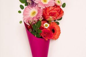 Bouquet of flowers in paper cone on