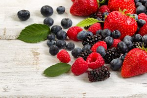 Fresh berries on white table