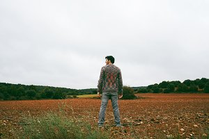 Young man alone and sad in nature