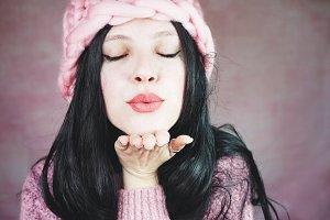 Beautiful young brunette woman kissi