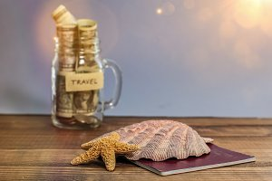 Saving money for travel in jar with