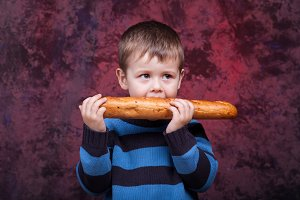 Little boy eating the french