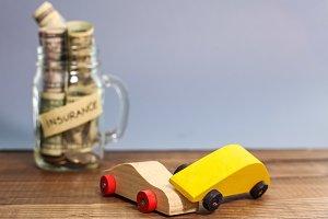 Money for car insurance in jar