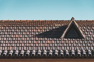 Window in a terracotta tiled roof