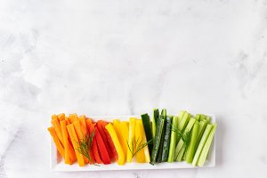 Colorful vegetable sticks in long pl