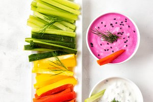 Colorful vegetable sticks with yogur