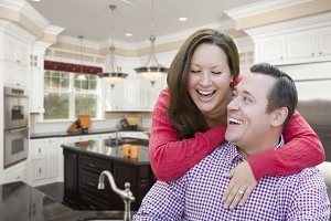 Happy Laughing Couple In Kitchen