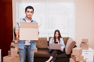 Young couple with cardboard box