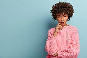 Portrait of thoughtful black woman w