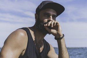 Bearded man model wearing black cap