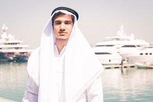 Young Arabian Man Next To A Yacht