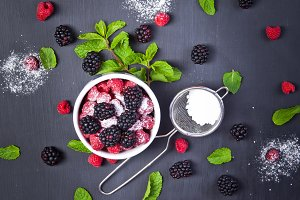 Assorted fresh berries with mint lea