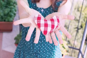 Heart in open hands of a child