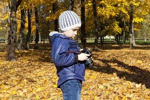 A boy walking in the park