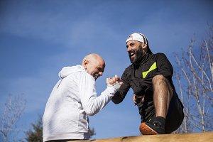 Two mature men running