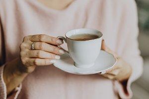 Woman enjoying a warm cup of tea