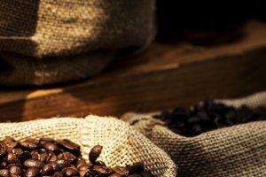 Freshly roasted coffee beans in sack