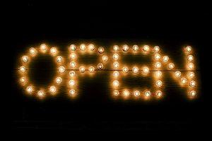 Light bulbs spelling open sign