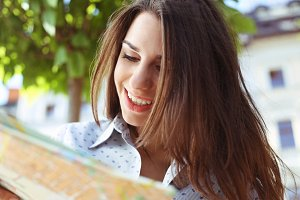 Smiling Woman With Map