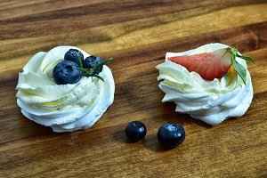 Pair of cream cakes with berries