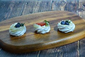 Set of cream cakes with berries