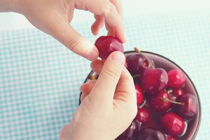 Child eating cherries