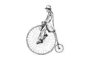 Man on retro vintage old bicycle