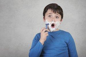funny child with razor
