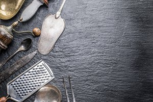 Kitchen utensils on the graphite bac