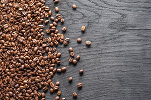 Roasted coffee beans on the old wood