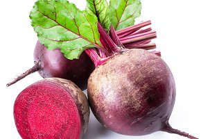 Red beets or beetroots on white back