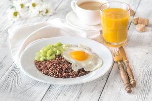 Portion of red quinoa with fried egg