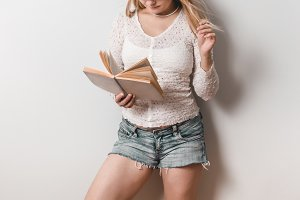 Casual young woman reading a book