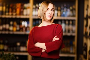 Image of blonde in store with wine