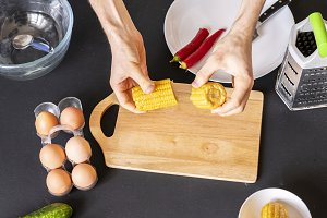 chefs hands cook yellow corn. nation