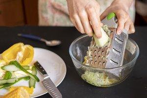 chef preparing salad from cucumbrer