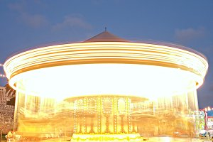 Lit carousel in motion