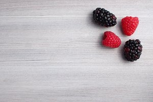 Berries on grey textured background
